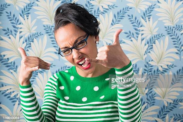 retro style portrait of woman with thumbs up - funky stock pictures, royalty-free photos & images