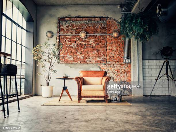 retro style shared office workspace interior - mattone foto e immagini stock