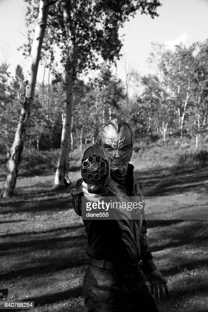 Retro Styled Alien Walking Through The Woods With A Gun
