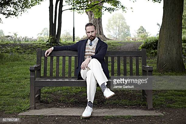retro styled male sat on a bench - eccentric stock pictures, royalty-free photos & images