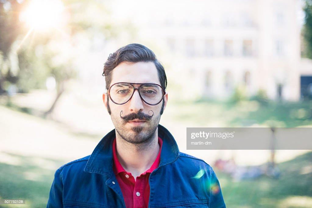 Retro styled man looking at camera : Stock Photo