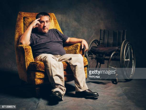 retro styled portrait of a disabled man - paraplegic stock photos and pictures