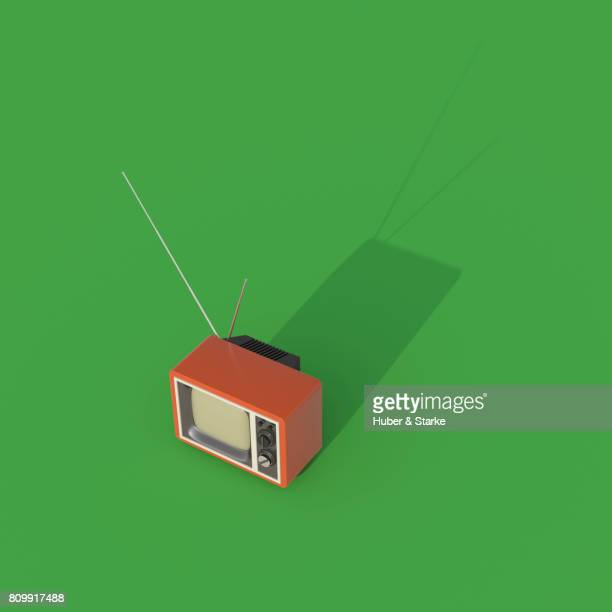 retro styled television set  on green background