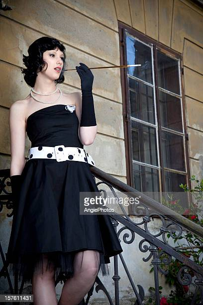 Retro styled woman smoking