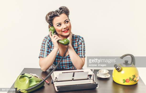 Retro styled woman using telephone