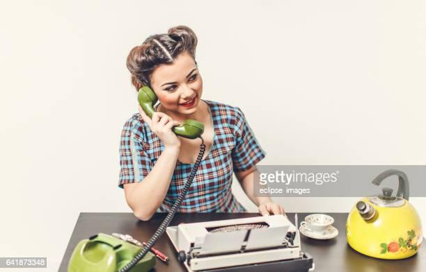 Retro styled woman using telephone