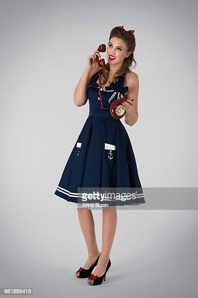 Retro styled woman with retro telephone. Debica, Poland