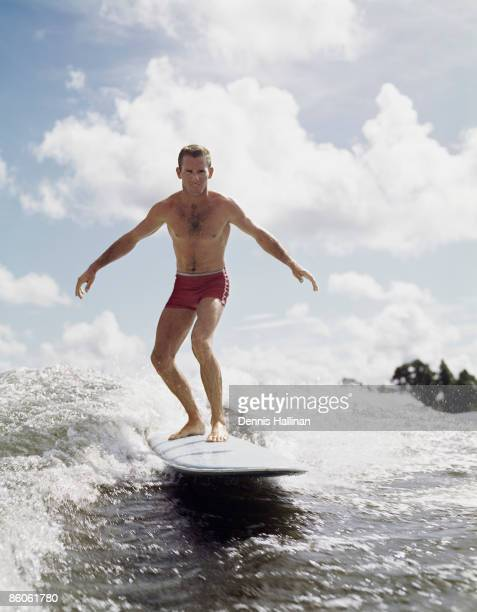 Retro surfer riding a wave