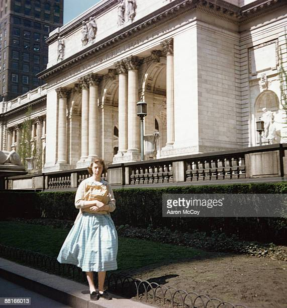 retro teenage girl standing outside library - new york public library stock pictures, royalty-free photos & images