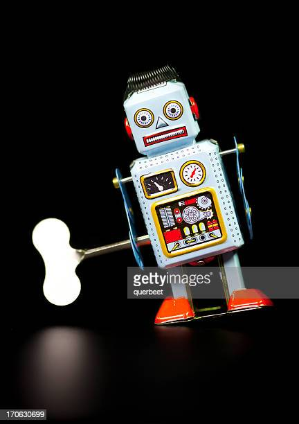 retro tin robot - wind up toy stock photos and pictures