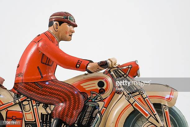retro tin toy motorcycle  rider dressed in red jacket. - vintage motorcycle stock pictures, royalty-free photos & images