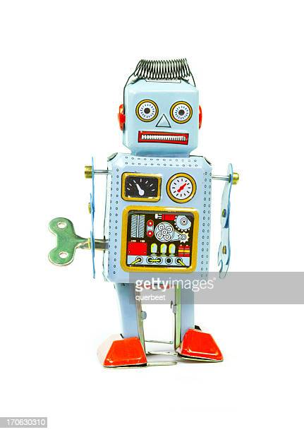 retro tin toy robot - wind up toy stock photos and pictures