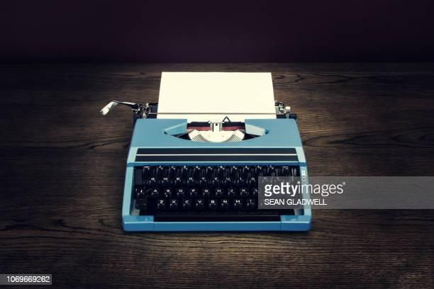 retro typewriter on desk - typewriter stock pictures, royalty-free photos & images