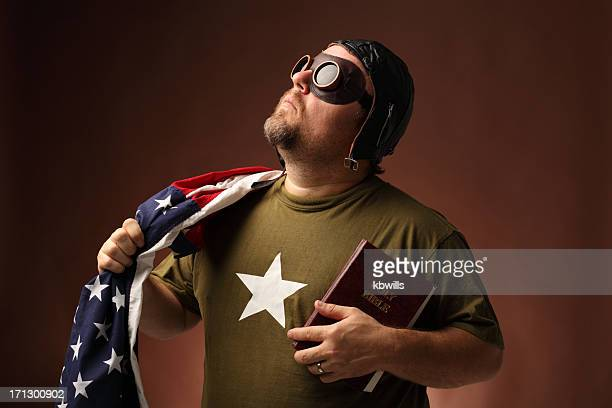 retro us airman with flag and bible looks up