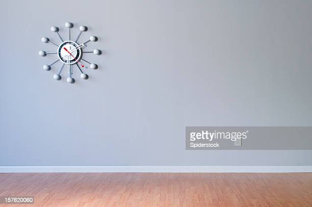 Retro Wall Clock In Empty Room