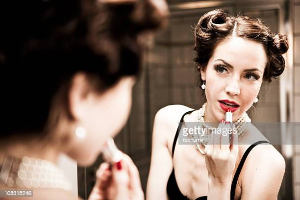 Retro Woman Applying Lipstick in Mirror