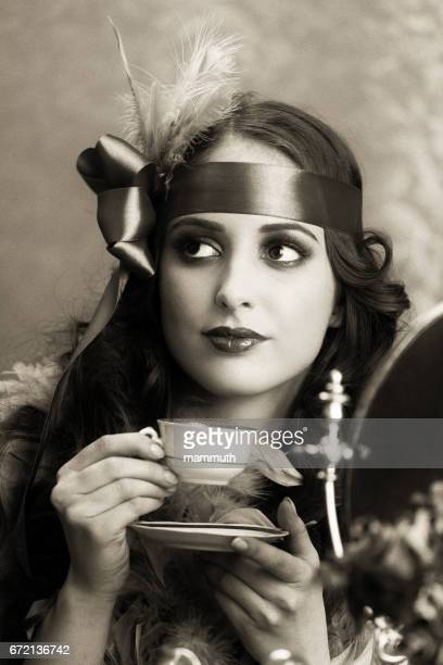 retro woman drinking coffee - 20th century stock photos and pictures