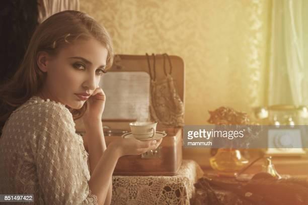 Retro woman drinking hot coffee