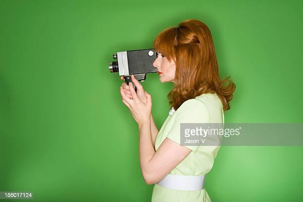 Retro woman filming