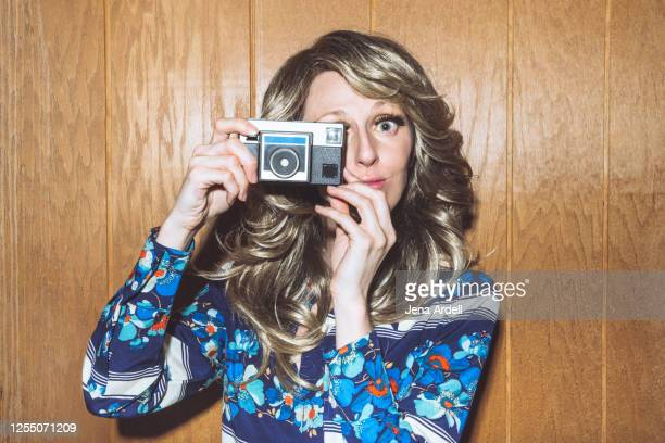 retro woman holding camera, woman taking a photo, funny retro woman - 1970 stock pictures, royalty-free photos & images
