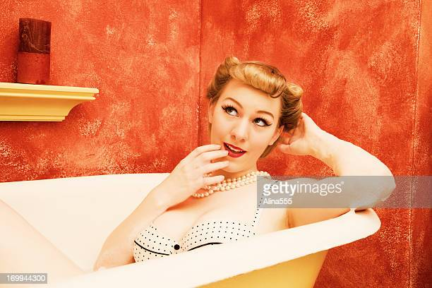Retro woman in an old-fashioned bathtub - pinup style