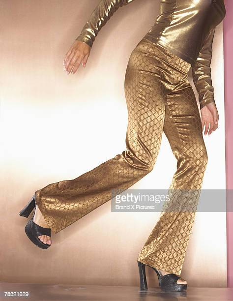 Retro woman in gold disco dancing