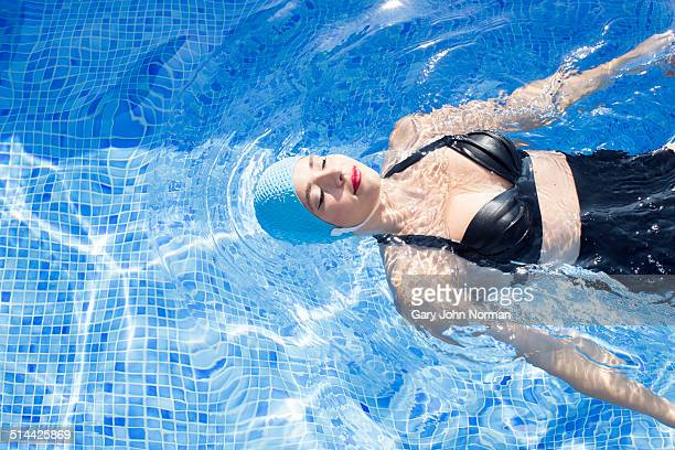 Retro woman in swimming pool