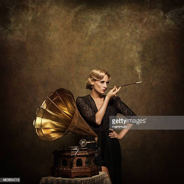 Retro woman listening to music and smoking cigarette