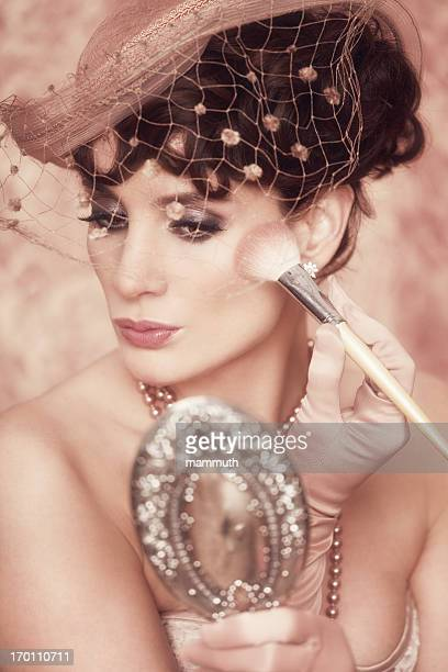 retro woman powdering face