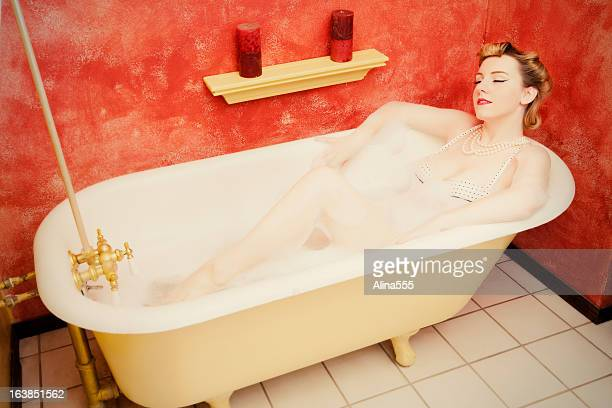 retro woman relaxing in an old-fashioned bathtub - pinup style - 1940s erotica stock photos and pictures