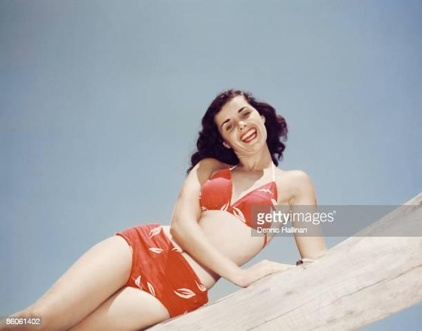 Retro woman smiling posing in a bikini
