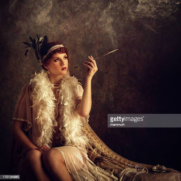 retro woman smoking cigarette - roaring 20s stock photos and pictures