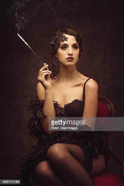 retro woman smoking cigarette - corset stock pictures, royalty-free photos & images