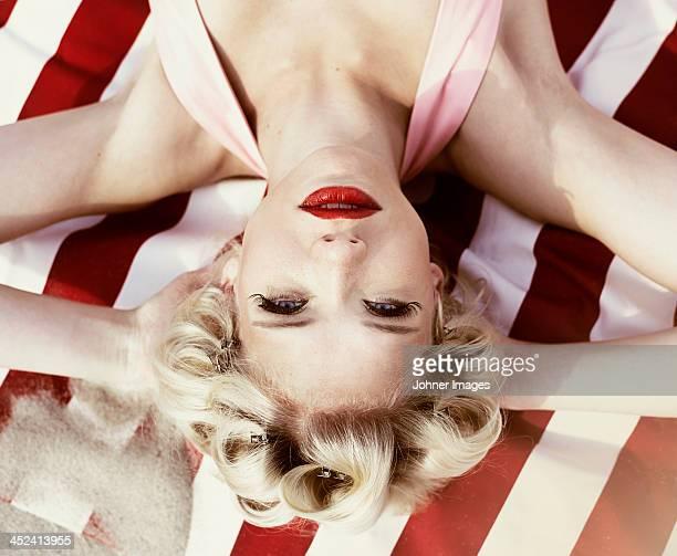 Retro woman sunbathing, high angle view