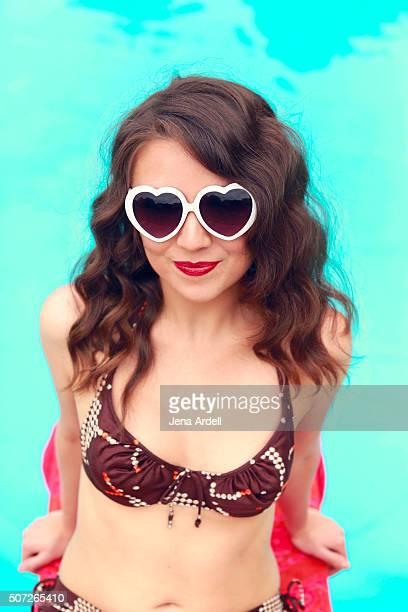 Retro woman wearing heart shaped sunglasses
