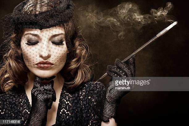 Retro woman with cigarette holder