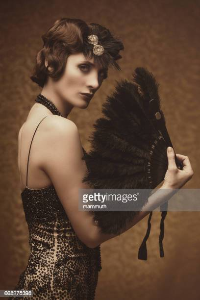 Retro woman with feather fan