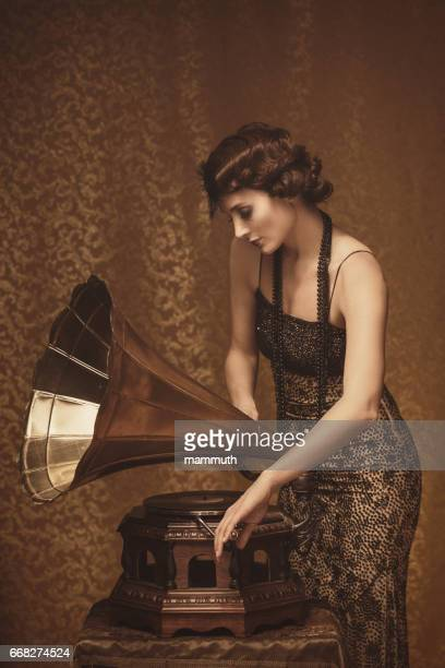 retro woman with gramophone - roaring 20s party stock photos and pictures