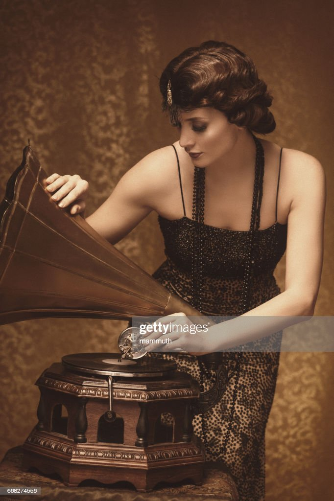 Retro woman with gramophone : Stock Photo