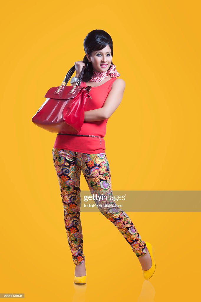 Retro woman with hand bag : Stock Photo