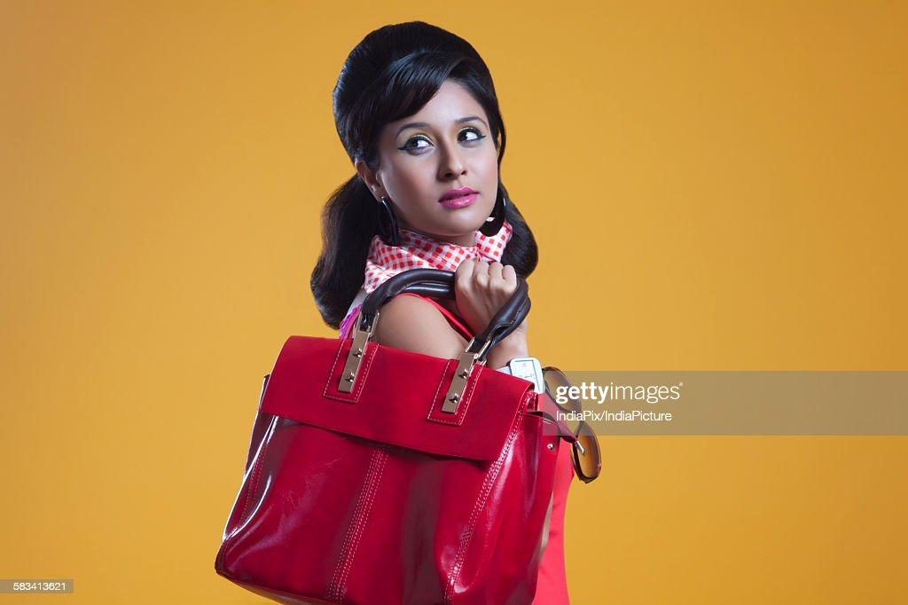 Retro woman with hand bag : Stock Photo