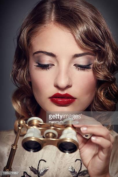 retro woman with opera glasses