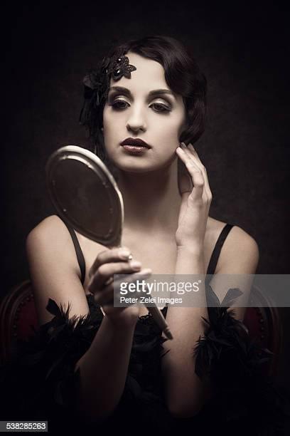 Retro woman with silver mirror