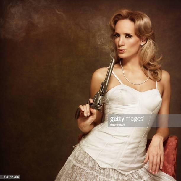 retro woman with smoking gun