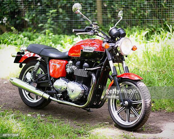 retro-style 2012 triumph bonneville motorcycle - triumph motorcycle stock pictures, royalty-free photos & images