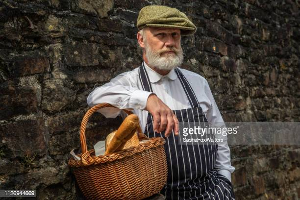 retro-style baker selling bread - home front stock pictures, royalty-free photos & images