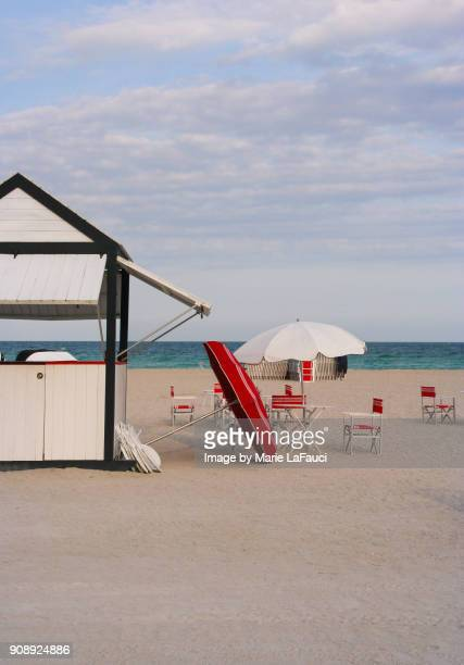 Retro-style cabana hut with beach chairs and umbrellas