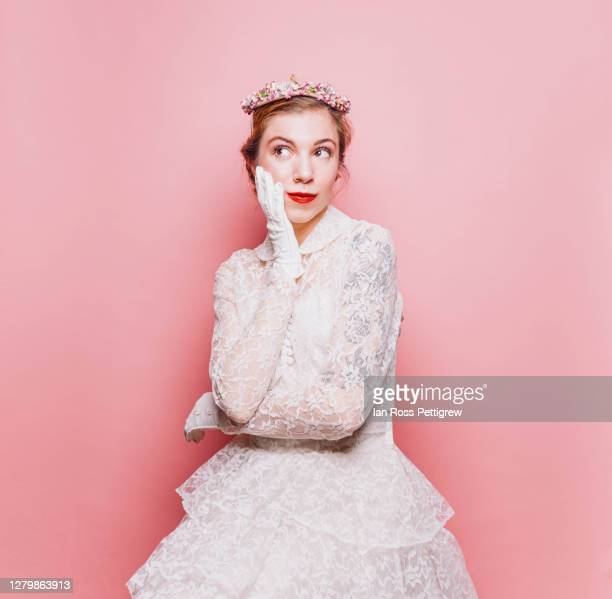 retro-styled elegant woman in white dress and flowered hat - lace glove stock pictures, royalty-free photos & images