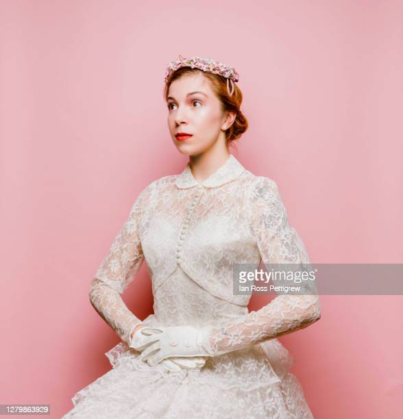 retro-styled elegant woman in white dress and flowered hat - lace dress stock pictures, royalty-free photos & images
