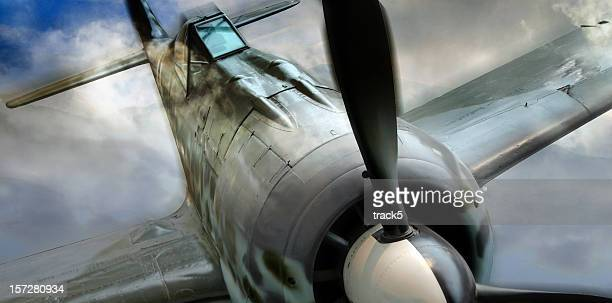 retro-styled german fock-wulf 190 wwii fighter plane in action - spitfire stock pictures, royalty-free photos & images